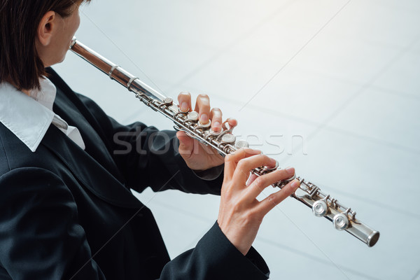 Woman playing transverse flute Stock photo © stokkete