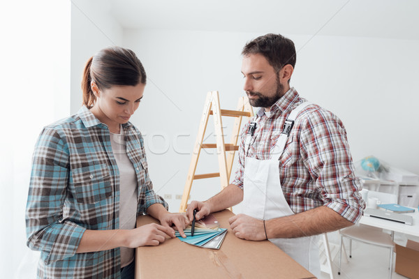 Woman picking a color for her walls Stock photo © stokkete
