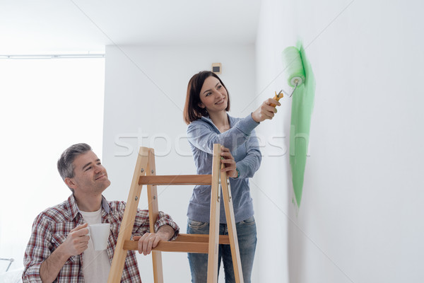 Couple painting walls together Stock photo © stokkete