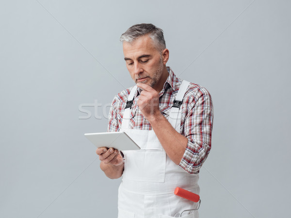 Painter using a digital tablet Stock photo © stokkete