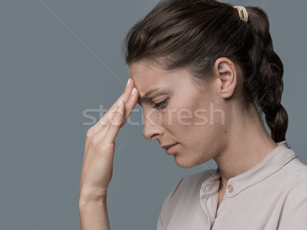 Tired woman with headache Stock photo © stokkete