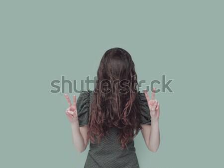 Nieśmiała kobieta ukrywanie za włosy funny Zdjęcia stock © stokkete
