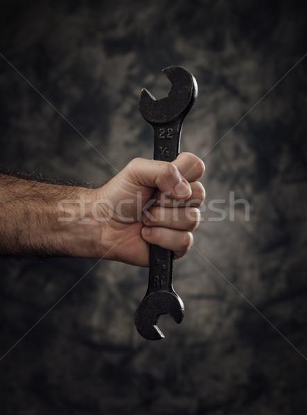 работник гаечный ключ темно рабочие Сток-фото © stokkete
