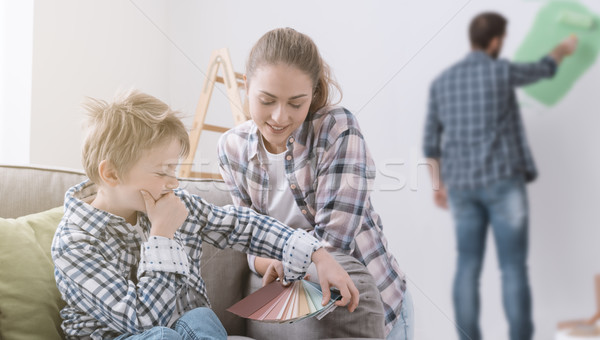 Boy picking paint colors Stock photo © stokkete