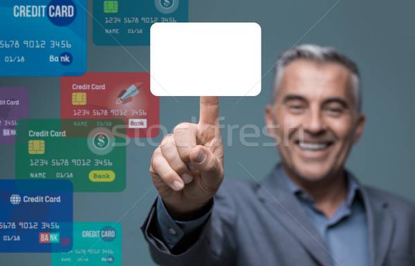 Businessman selecting a payment method Stock photo © stokkete