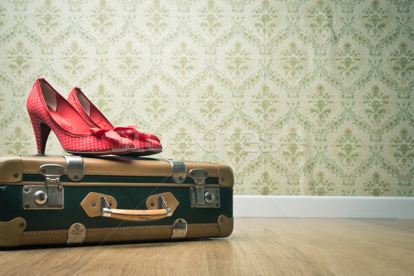 Vintage suitcase and red shoes Stock photo © stokkete