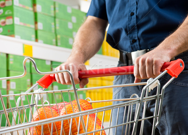 Man with shopping cart Stock photo © stokkete