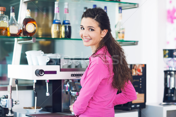 Barista making coffee with a coffee machine Stock photo © stokkete