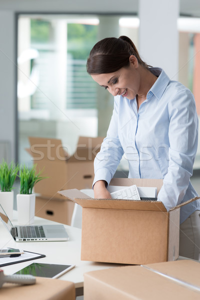 Business woman unpacking in her new office Stock photo © stokkete