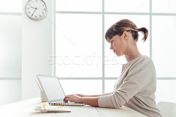 Efficient businesswoman at work Stock photo © stokkete