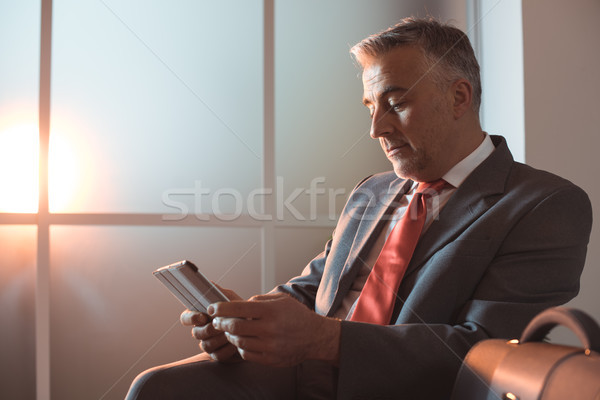 Executive connecting with a tablet Stock photo © stokkete