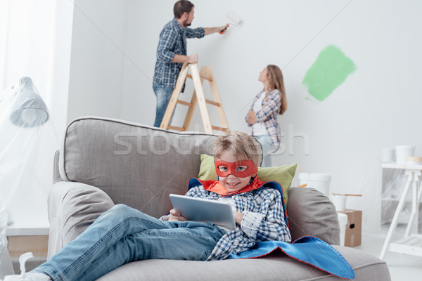 Superhero using a tablet and home makeover Stock photo © stokkete