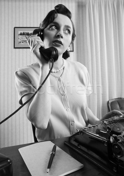 Office Worker talking on the phone Stock photo © stokkete