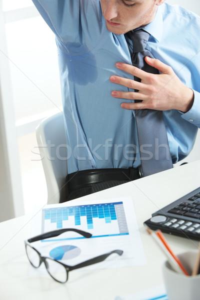 Affaires transpiration jeunes homme d'affaires affaires hommes Photo stock © stokkete