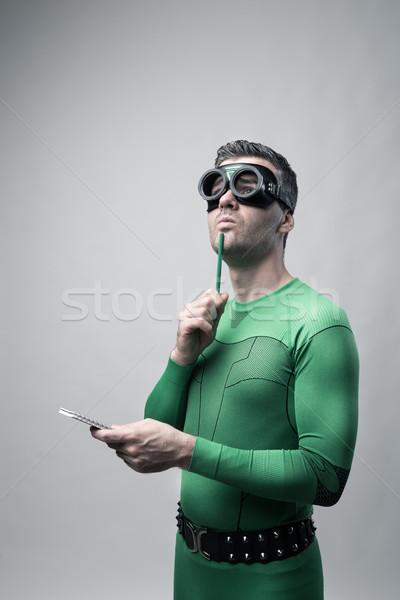 Superhero thinking with green pencil Stock photo © stokkete