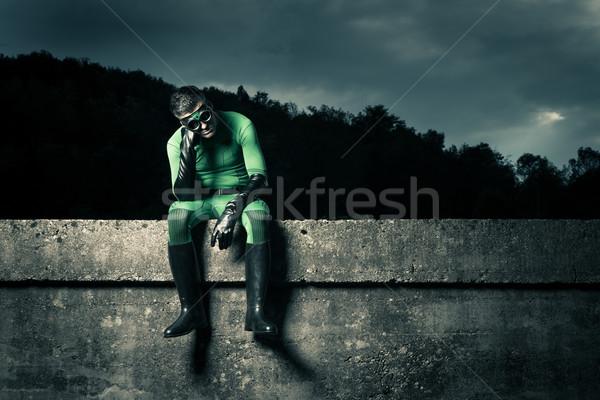 Pensive green superhero Stock photo © stokkete