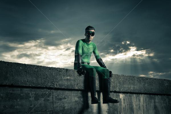Superhero with dramatic sky on background Stock photo © stokkete