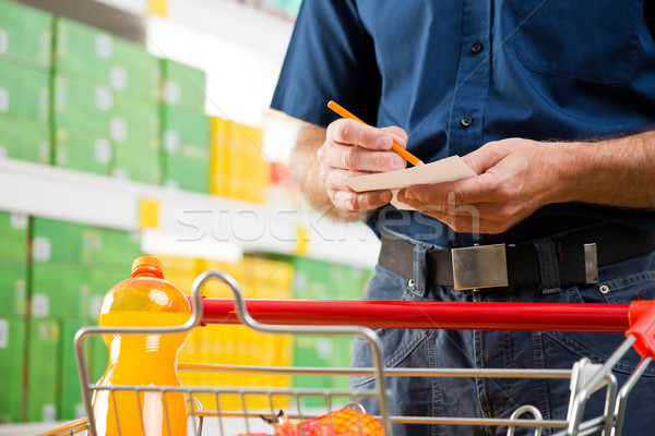 Checking shopping list Stock photo © stokkete