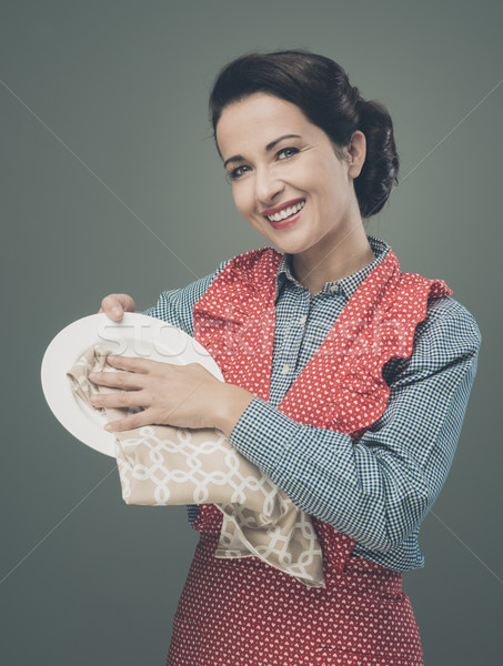 VIntage housewife polishing dishware Stock photo © stokkete