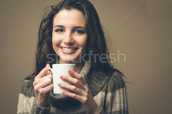красивая женщина горячий напиток улыбаясь Кубок стекла Сток-фото © stokkete