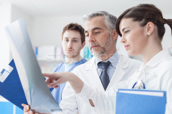 Medical team examining an x-ray Stock photo © stokkete