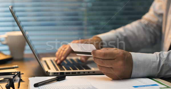 Businessman doing online banking Stock photo © stokkete