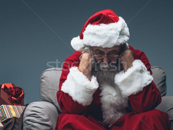 Nervous Santa Claus on Christmas eve Stock photo © stokkete
