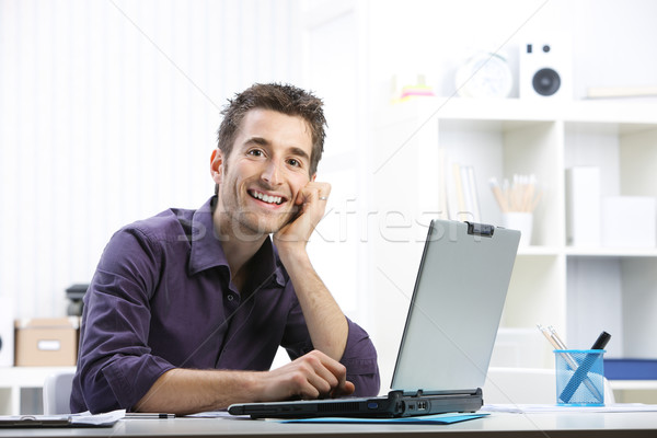 Young man working on laptop Stock photo © stokkete