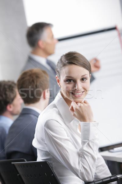 Réunion femme souriante séance réunion d'affaires collègues homme d'affaires Photo stock © stokkete