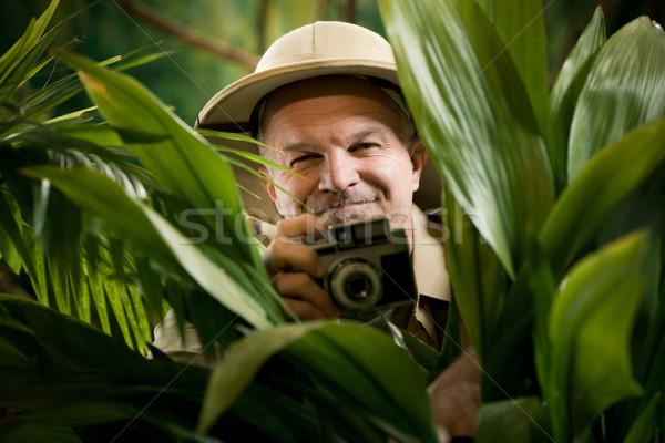 Stockfoto: Ontdekkingsreiziger · fotograaf · verbergen · vegetatie · foto's