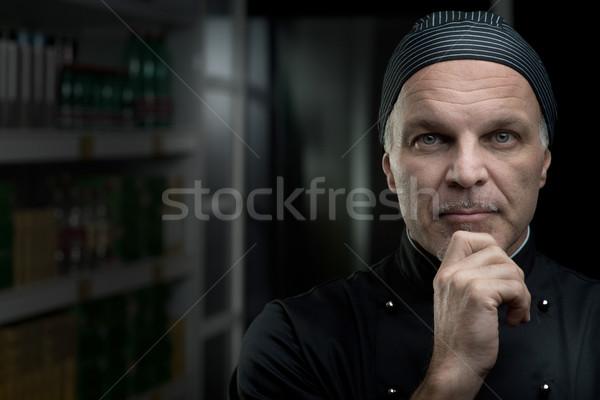 Szakács portré kéz áll sötét konyha Stock fotó © stokkete