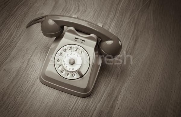 Vintage téléphone bois de feuillu surface gris bureau Photo stock © stokkete