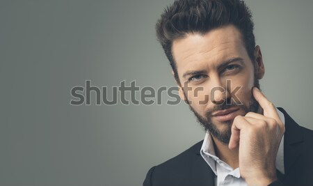Stock photo: Pensive young businessman