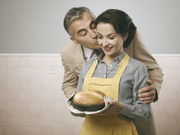 Vintage husband kissing his wife Stock photo © stokkete