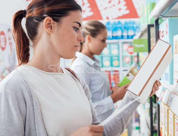 Women shopping at the supermarket Stock photo © stokkete