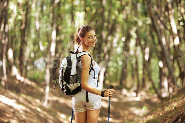 Female nordic walker Stock photo © stokkete