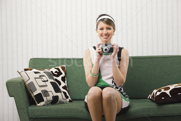 Smiling girl with vintage camera Stock photo © stokkete