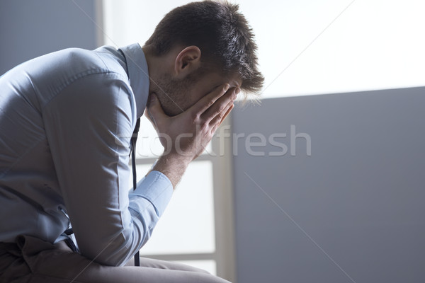 Tired pensive businessman Stock photo © stokkete