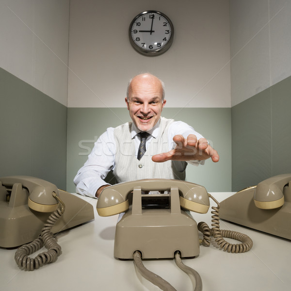 Office worker answering the phone Stock photo © stokkete