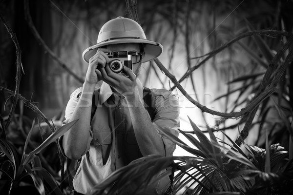 Young photographer in the jungle Stock photo © stokkete