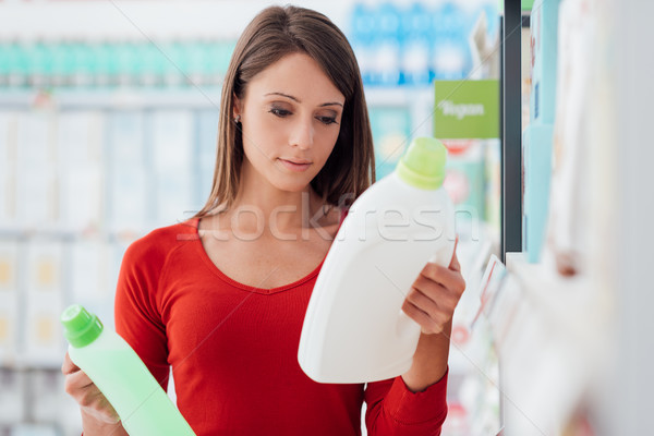 Woman comparing products Stock photo © stokkete