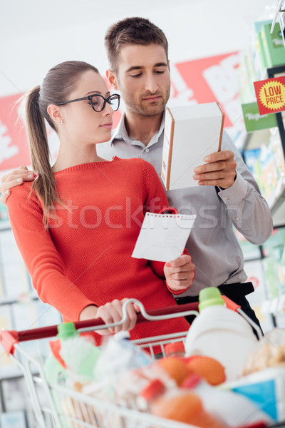 Couple shopping at the supermarket Stock photo © stokkete