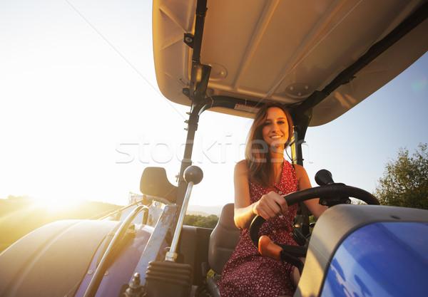 Chica de campo conducción tractor puesta de sol país Foto stock © stokkete
