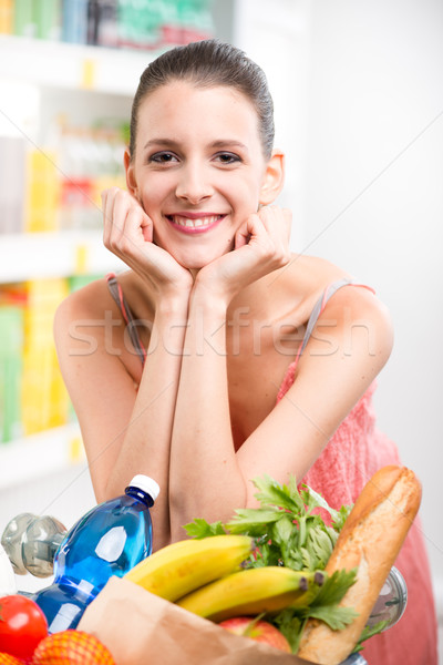 Woman shopping with hands on chin Stock photo © stokkete