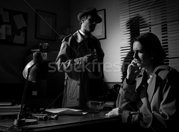 Detective interviewing a young pensive woman in his office Stock photo © stokkete