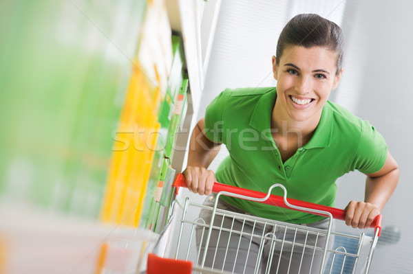 Enjoying shopping at supermarket Stock photo © stokkete