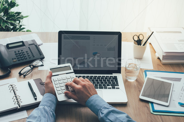 Businessman working in the office Stock photo © stokkete