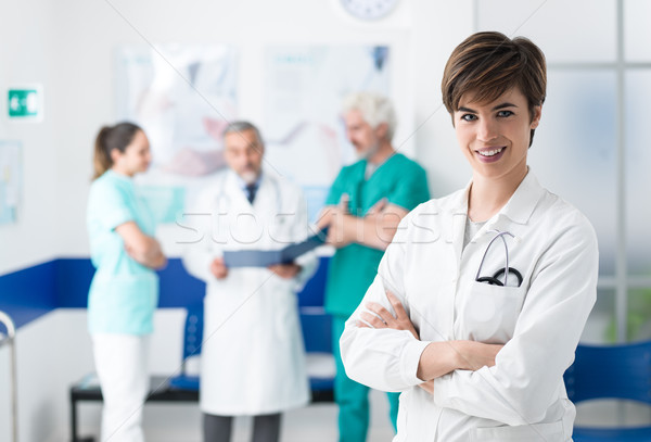 Medical team posing at the hospital and young doctor Stock photo © stokkete