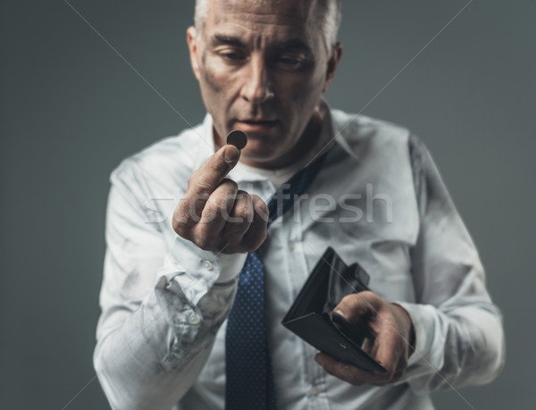 Jobless businessman with empty wallet Stock photo © stokkete