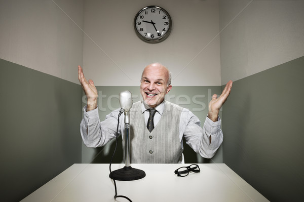 Businessman on the microphone Stock photo © stokkete